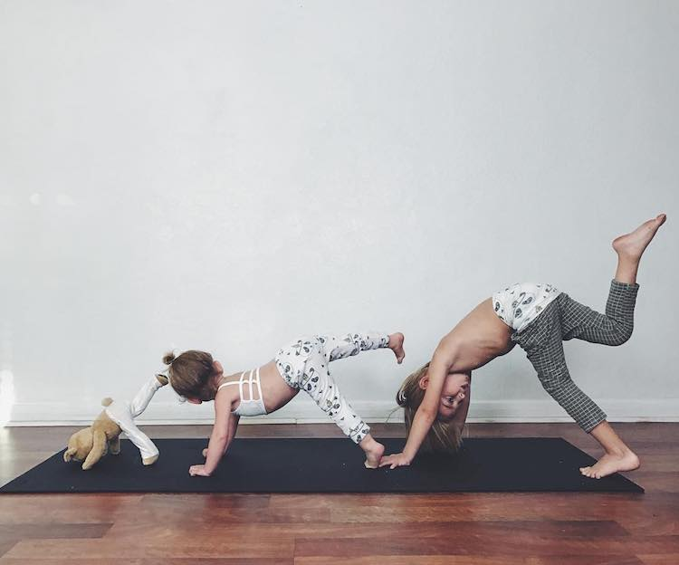 Mom Practice Family Yoga with the Help of Her Two Kids