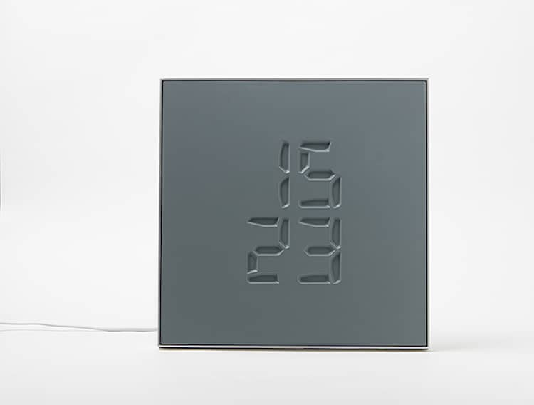Etch Clock engraved sculpture