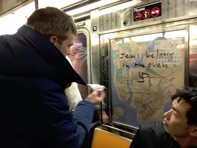 New Yorkers Remove Swastikas on Subway Car