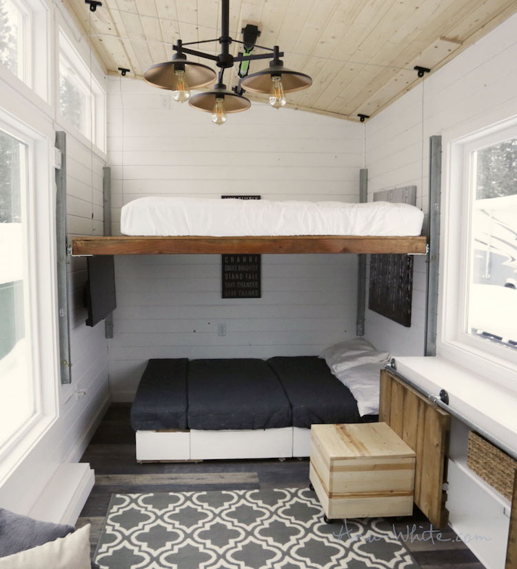 Elevating bed turns tiny house into modern and spacious home Four lights tiny house plans