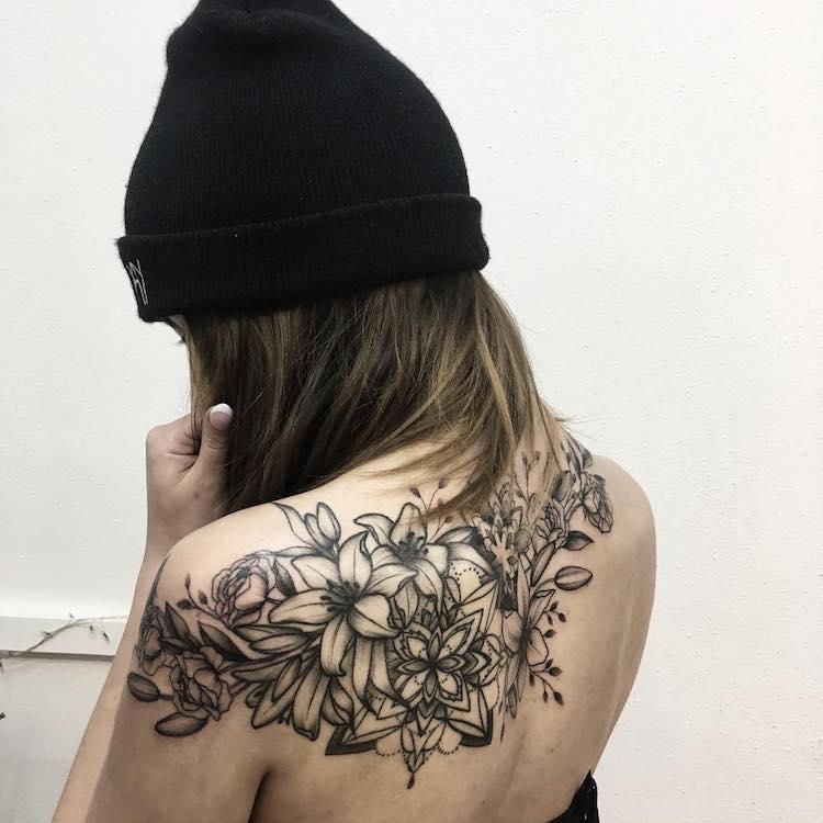Bold Flower Tattoos Gracefully Drape Across the Body