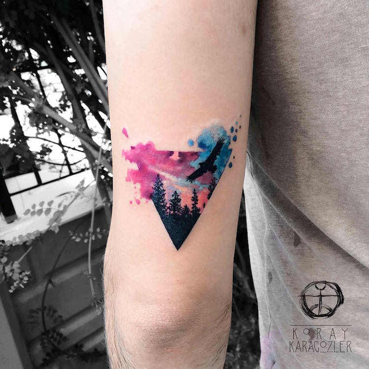 triangle landscape watercolor tattoo by Koray Karagözler