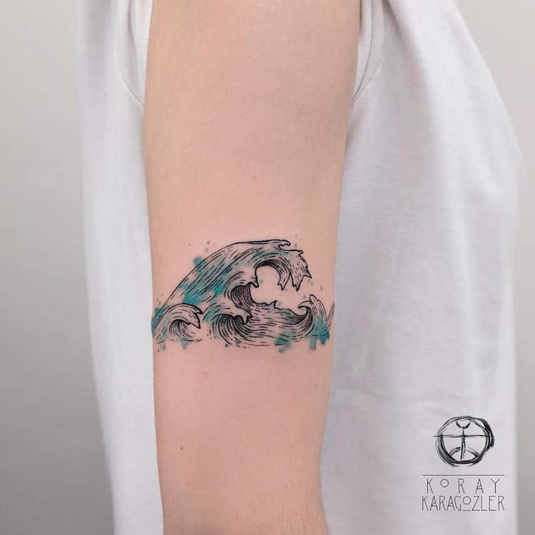 the great wave watercolor tattoo by Koray Karagözler