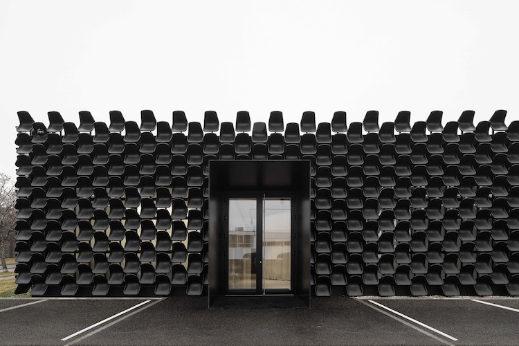 unique architecture has 900 black chairs on furniture gallery exterior. Black Bedroom Furniture Sets. Home Design Ideas
