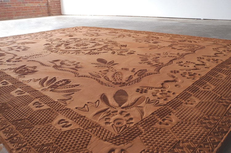 Artist Rena Detrixhe creates ephemeral patterned rugs from red dirt