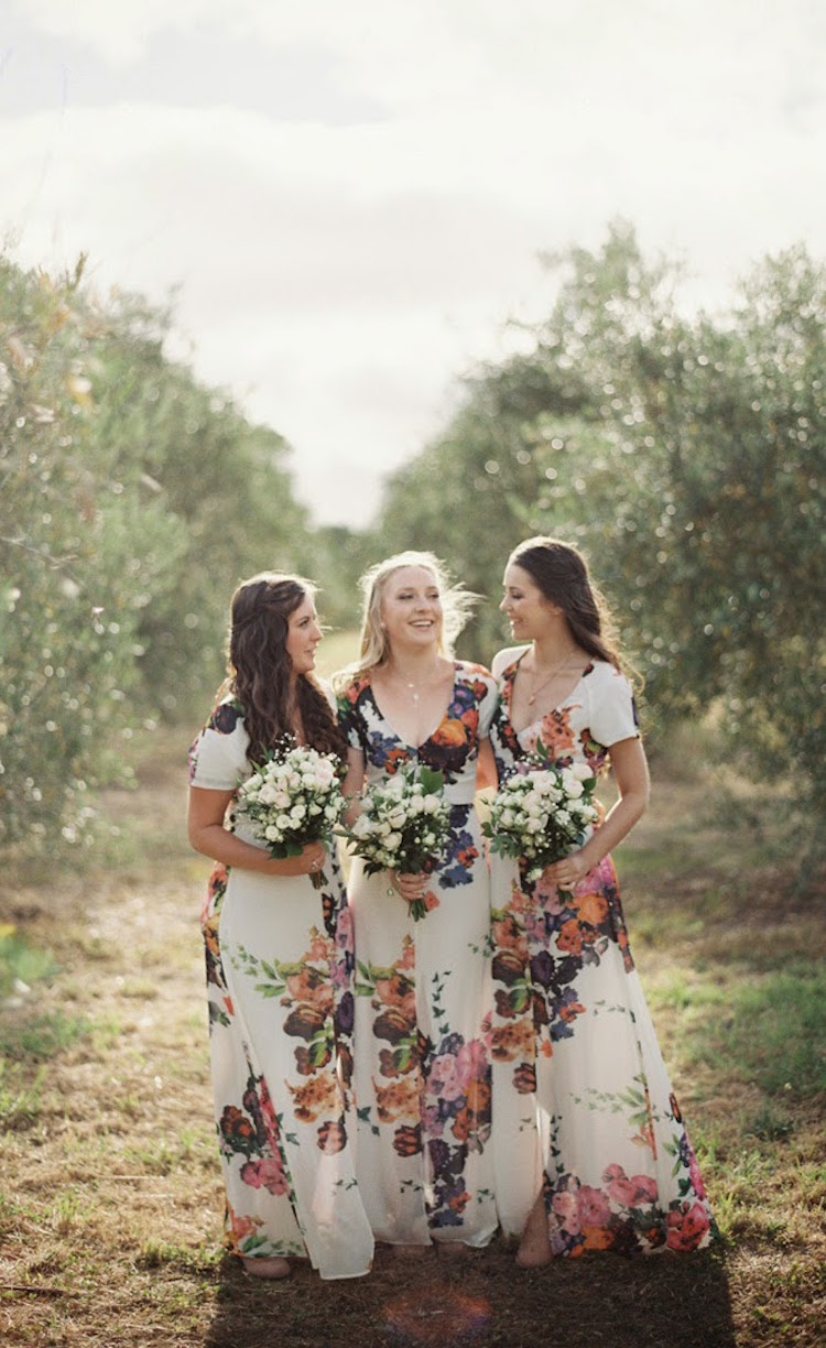 Floral bridesmaid dresses are the latest trend in wedding party attire floral bridesmaid dresses floral print bridesmaid dresses bridesmaid gown ombrellifo Images