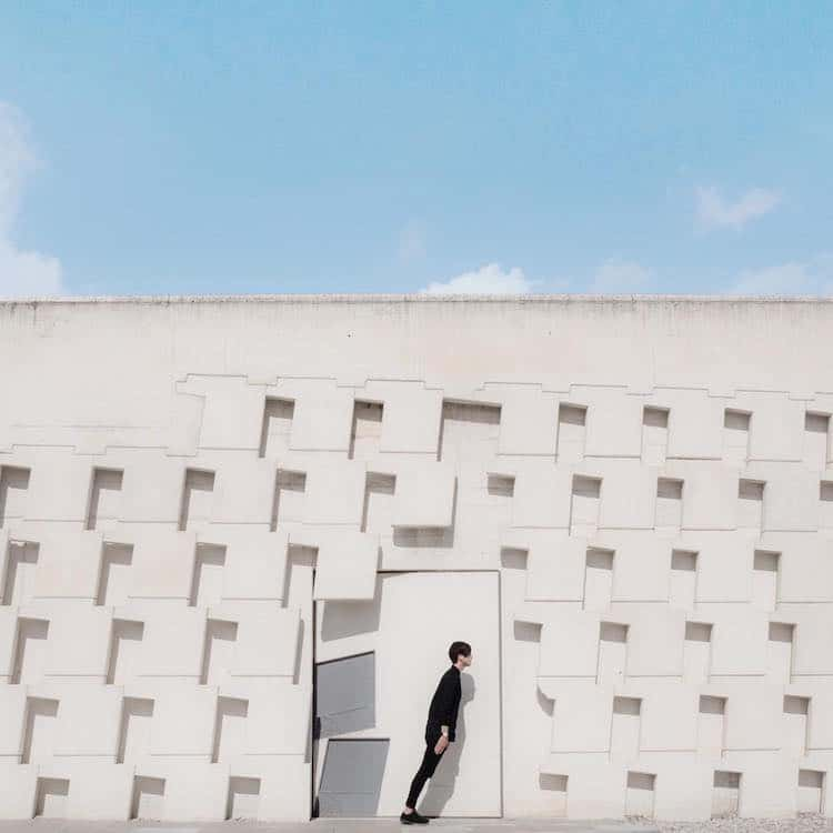white building architecture architecture photography shows couple with buildings around the world