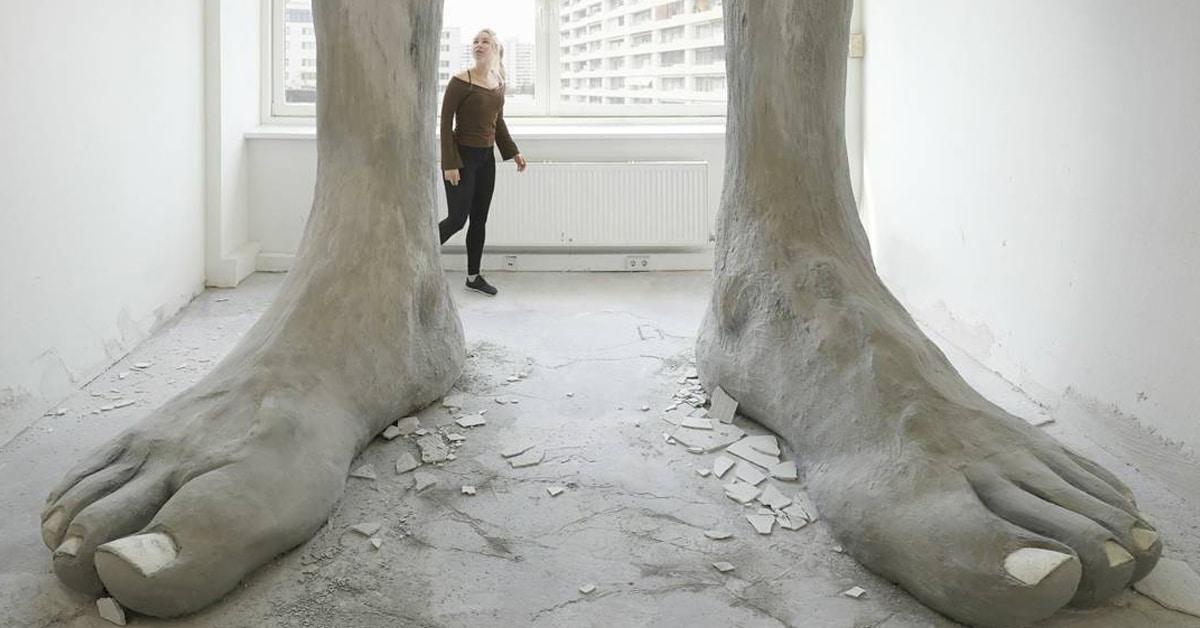 Giant Feet Crash Through Ceiling In Unique Foot Sculpture