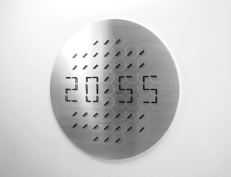 kinetic sculpture clock humans since 1982