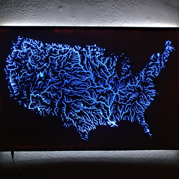 Man Uses Blue Resin To Create Illuminated Map Of Intricate Waterways Across The U S