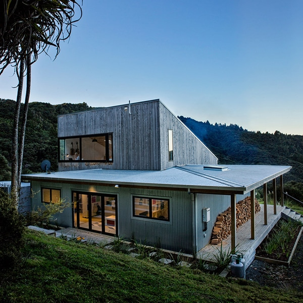 architect designs modern rustic home that merges with new zealand landscape