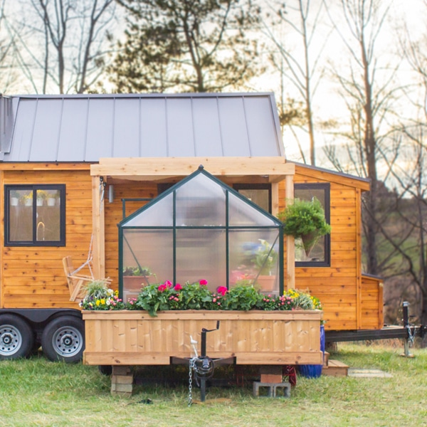 tiny mobile home is equipped with a flourishing green house. Black Bedroom Furniture Sets. Home Design Ideas