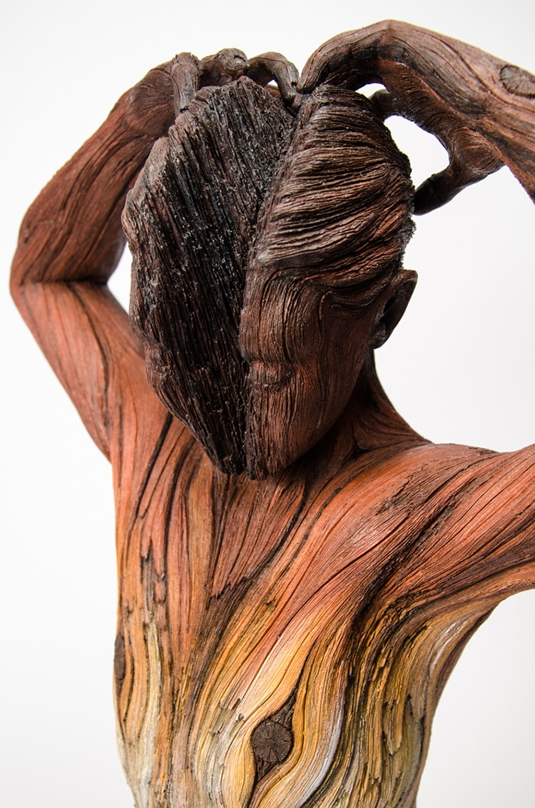 artist makes surreal tree bark textured ceramic sculptures