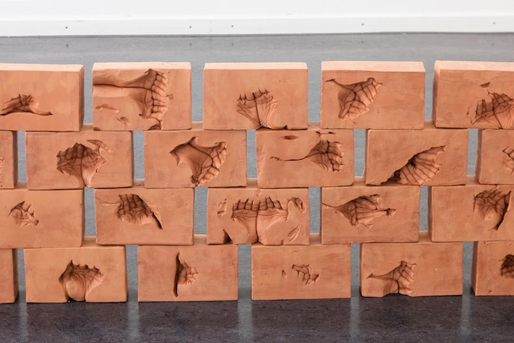 Artist Imprints Cupped Hands Into Clay Bricks as Unique Memorial to Father