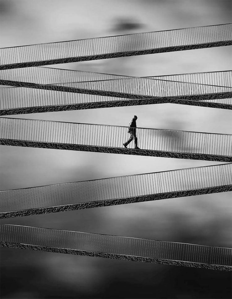 Person walking across bridge