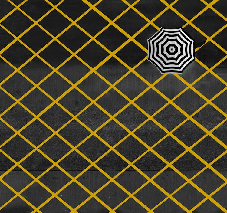 Black and white umbrella on yellow grid