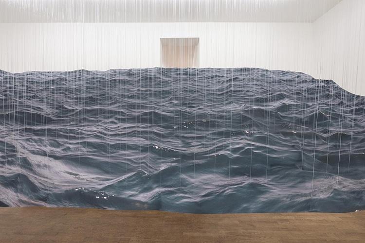 installation art made from fabric mimics a dark stormy ocean