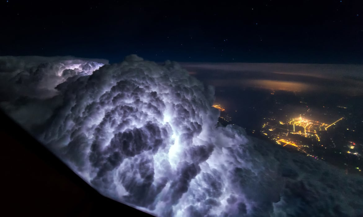 The chandelier that produces a shadow forest of wild trees pilot reveals how dramatic thunderstorms look from above the clouds arubaitofo Images