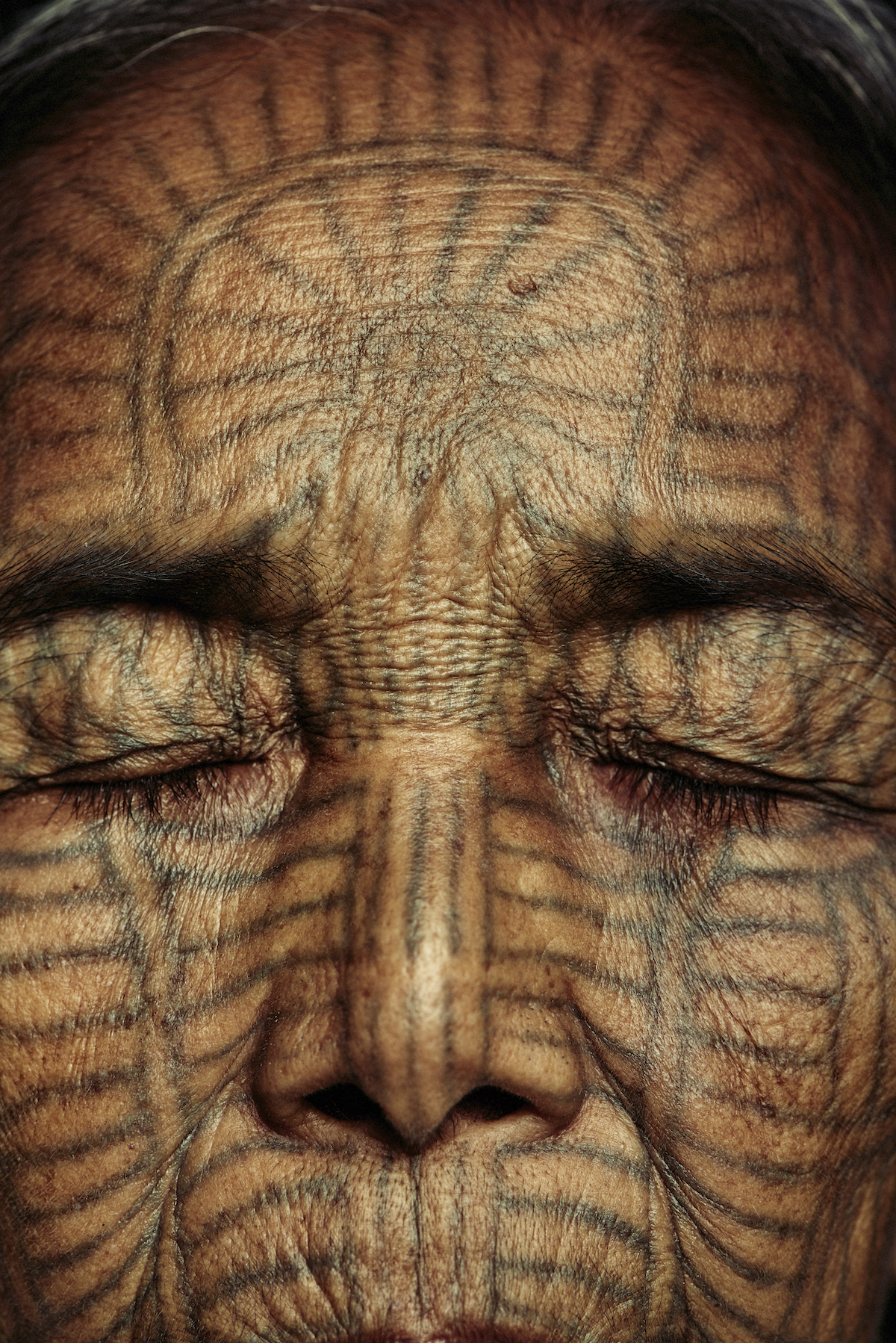 Traditional Chin Facial Tattoos
