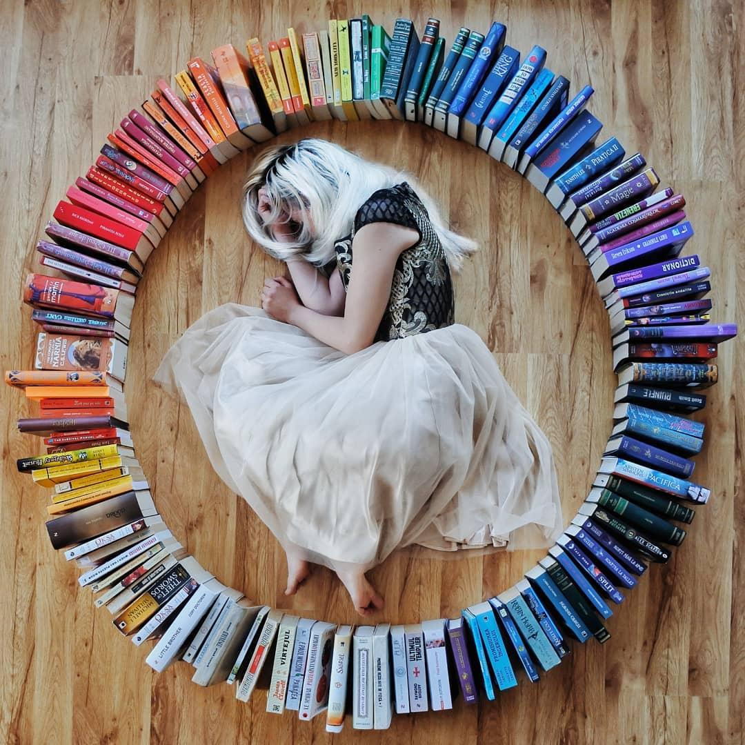 d69ab313c03 Girl Arranges Her Huge Library of Novels Into Imaginative Book Art ...