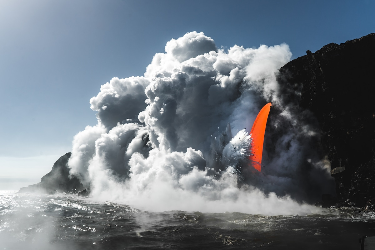 Lava spout viewed by boat at Hawaii Volcanoes National Park