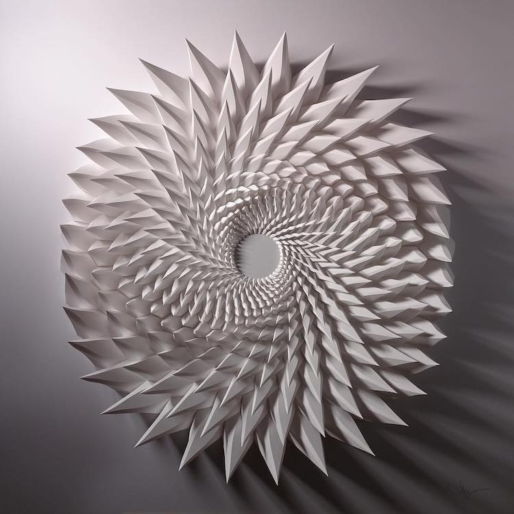 D paper sculpture transforms the material into dazzling