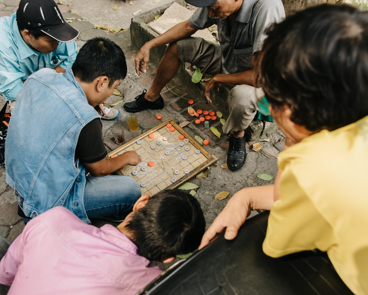 A group of men playing a game of Cu Tuong on the street in Hanoi