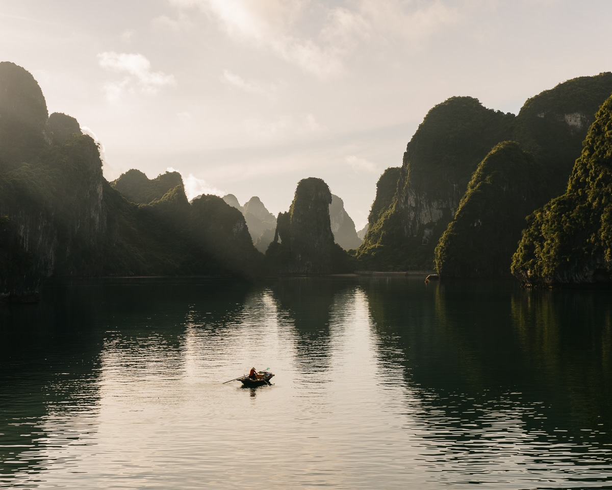 Limestone pillars rise from the emerald waters of Vietnam's Halong Bay.