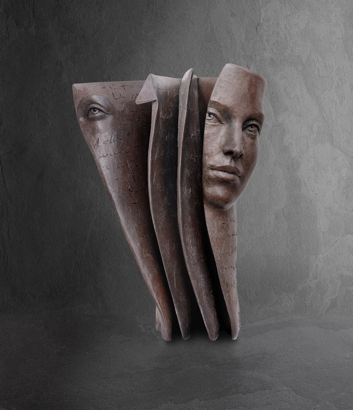 Face Emerging from Book by Sculptor Paola Grizi