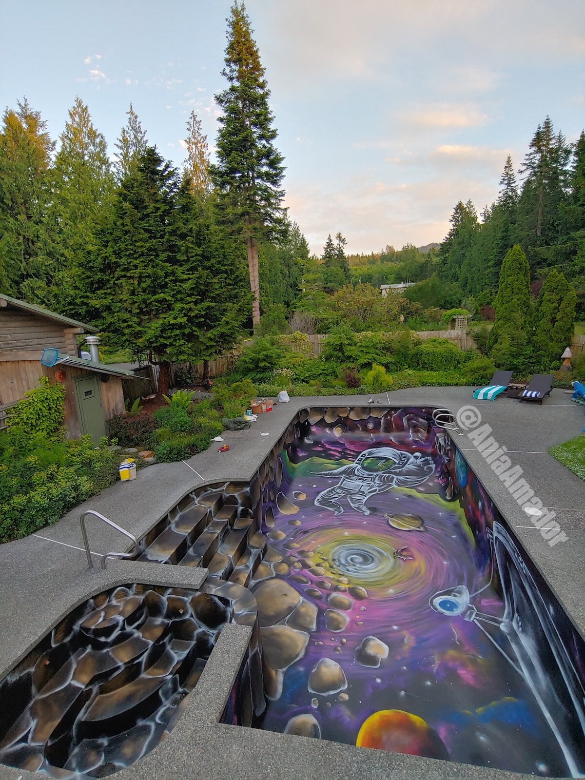 Swimming Pool Mural Transforms the Basin Into Outerspace