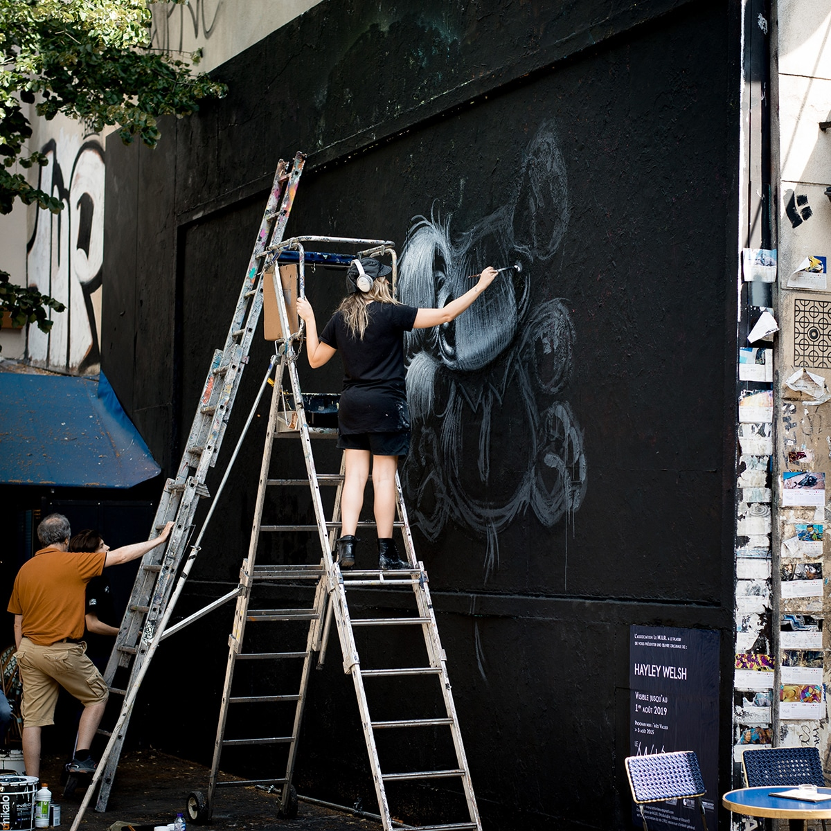 Female Street Artist Painting Mural