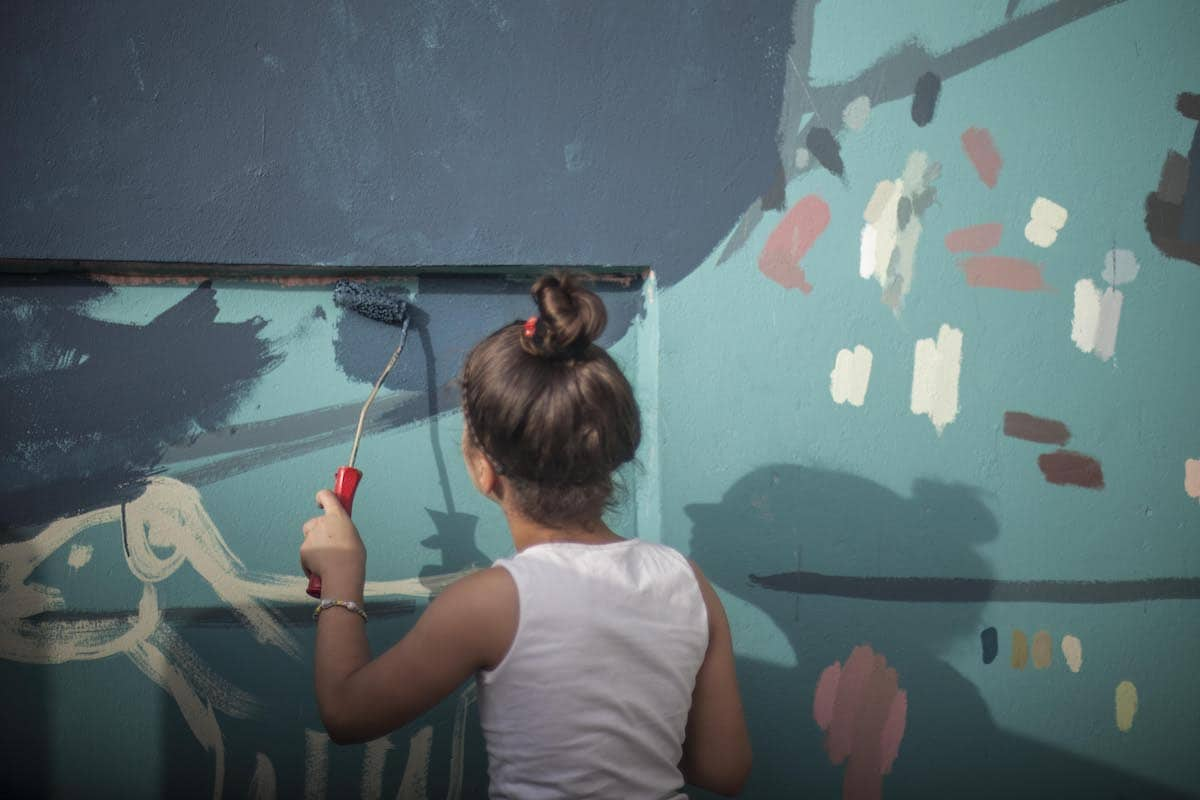 Girl Painting a Mural