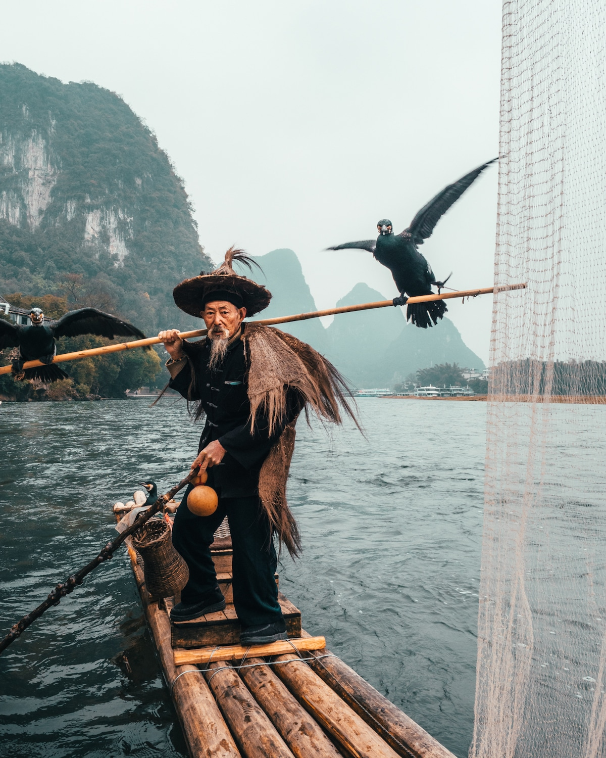 Cormorant fishing in China by Peter Yan Travel Photography