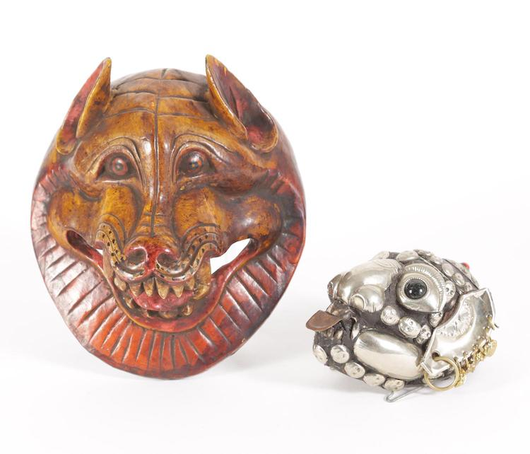 Nepalese Carved and Lacquered Wood Mask and a Tibetan Silver Decorated Animal Skull
