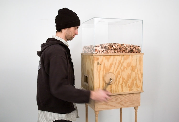 Man Cranking Machine That Emits Pennies by Blake Fall-Conroy