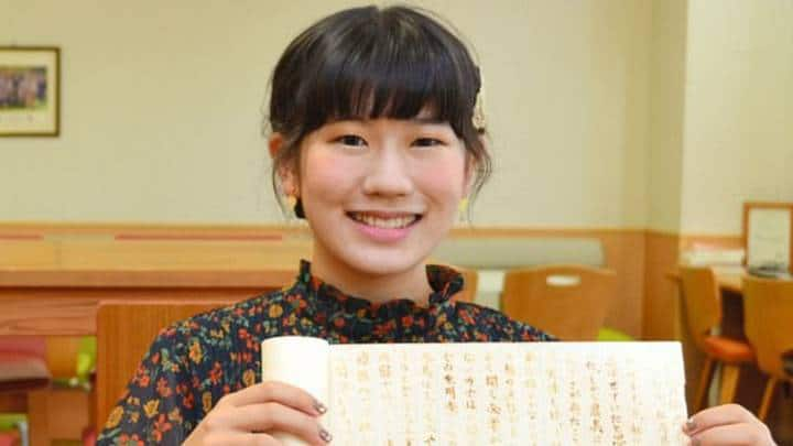 Student Eimi Haga Holding Her Ninja History Essay Written in Invisible Ink