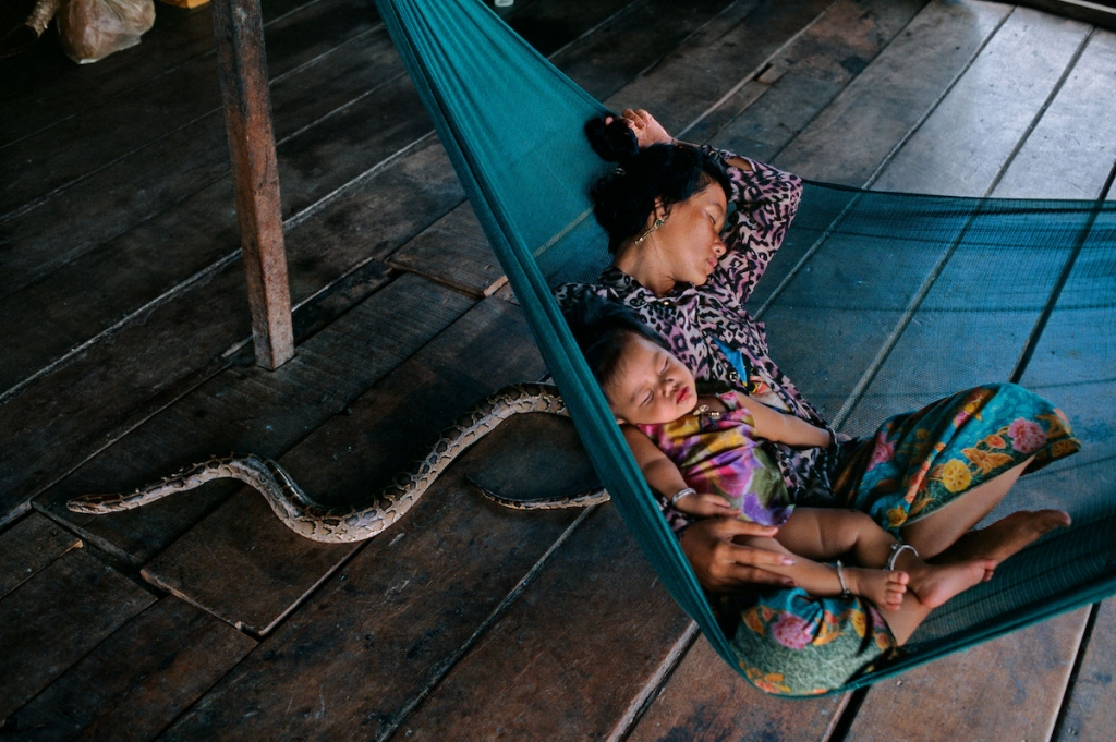 Mother and Child on Tonle Sap. Cambodia by Steve McCurry