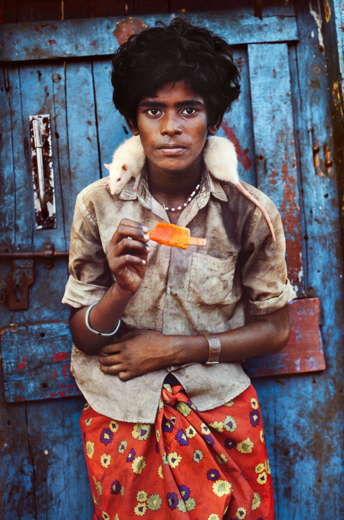 Boy with his Pet Rat in Galapagos by Steve McCurry