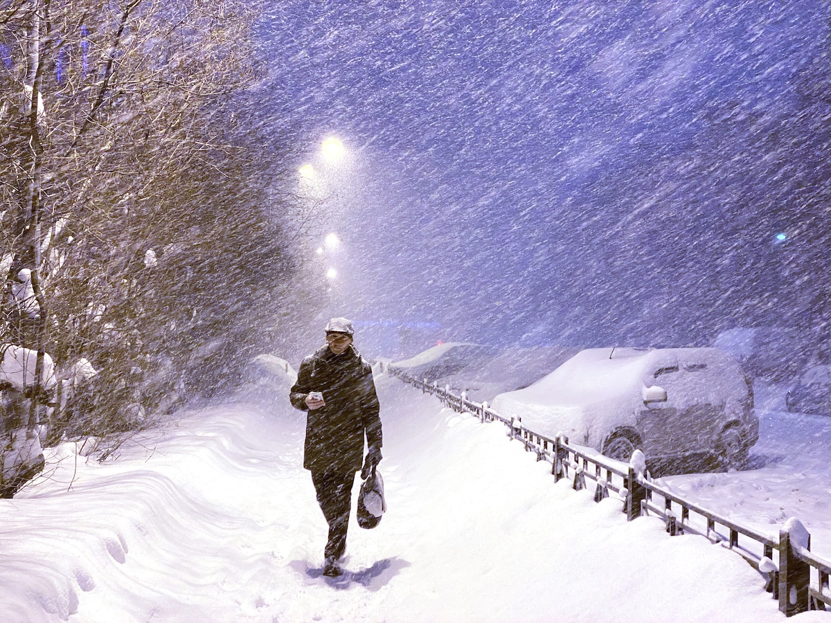 Man Walking Through a Blizzard in the Arctic Circle