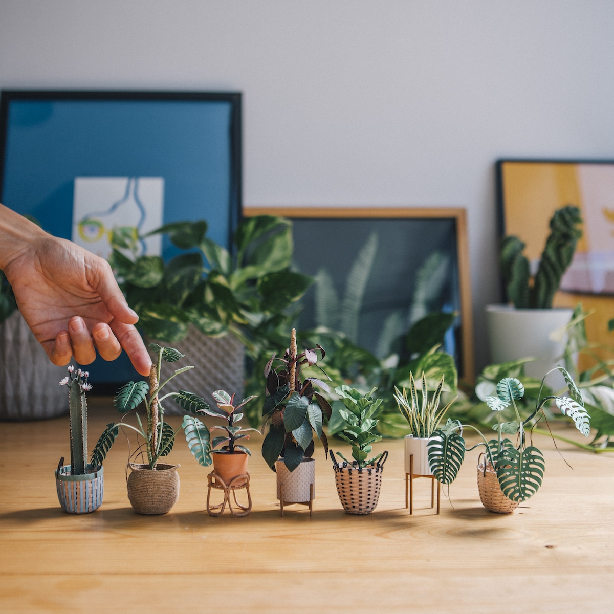 Paper Artist Creates Handmade Plant Sculptures That Fit On Your Fingers