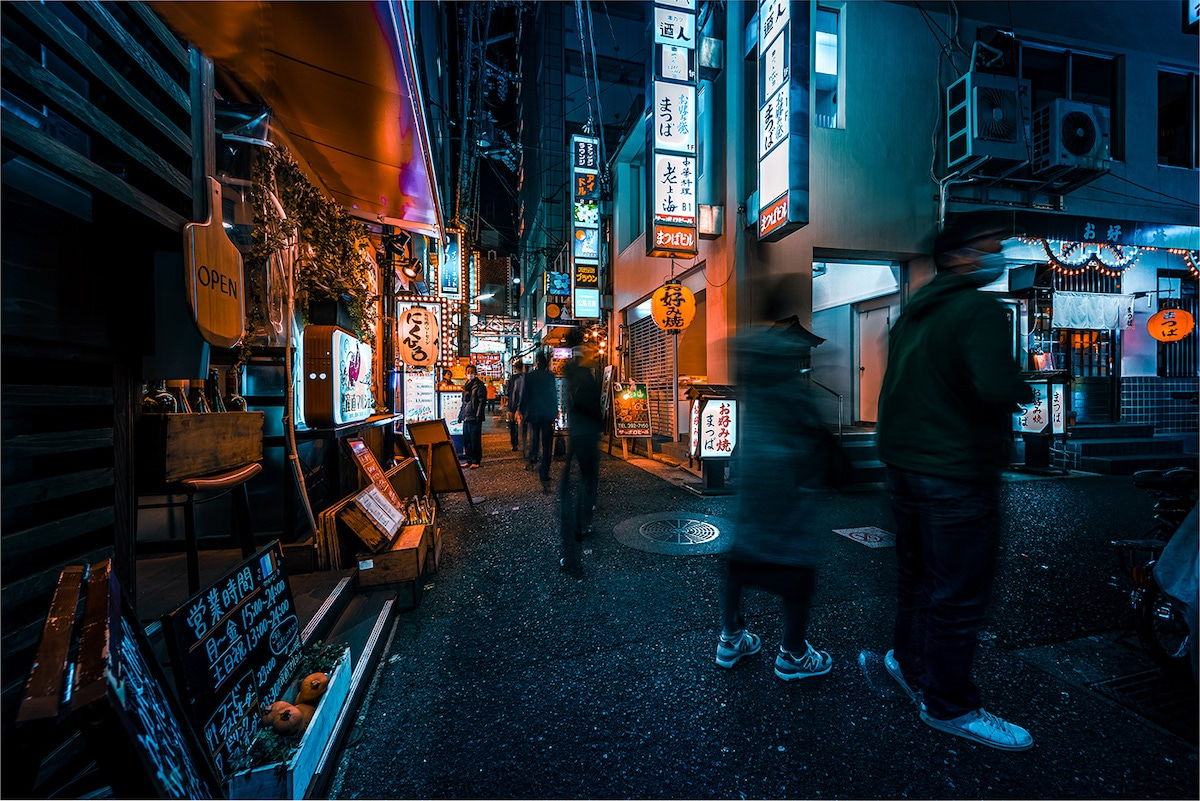 People Walking Down the Street at Night in Kobe, Japan