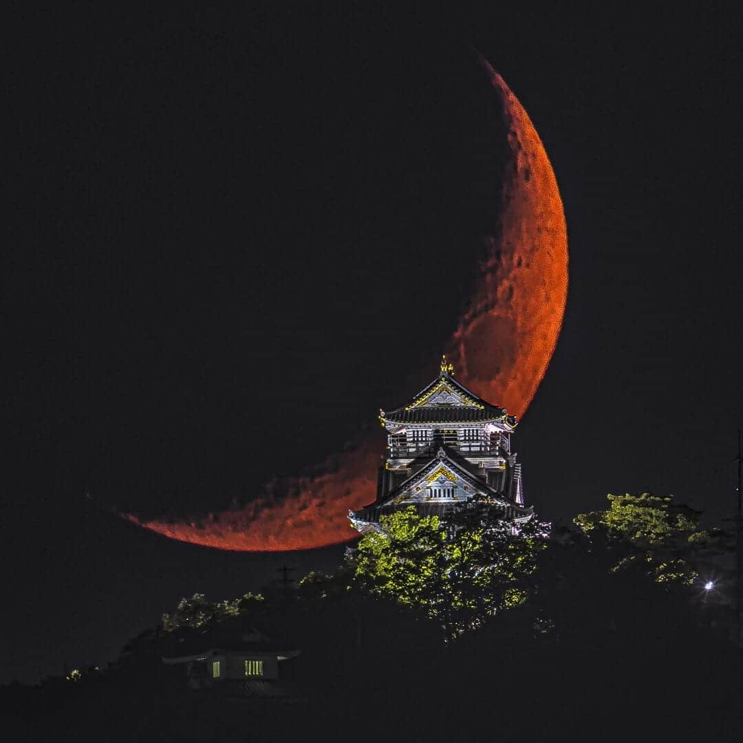 Gifu Castle in Japan with Red Moon Rising