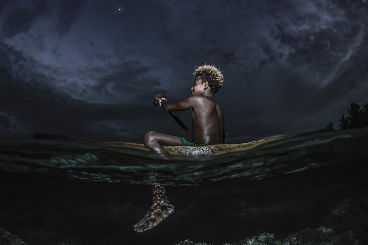 Boy on a Raft in the Solomon Islands