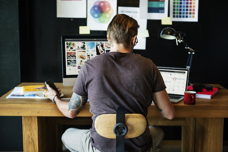 Man Sitting at a Desk and Working from Home