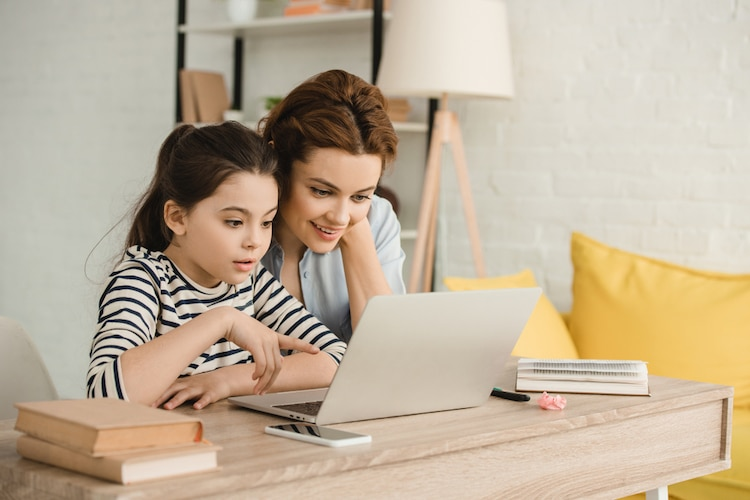 Mother and Daughter Using a Computer Together