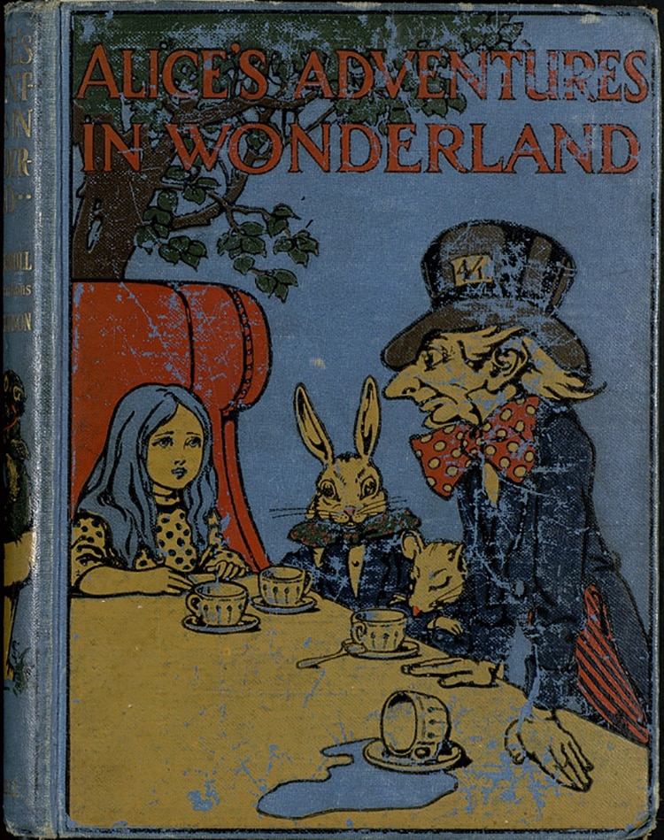 a young girl sits beside a rabbit and a man in a top hat drinking tea