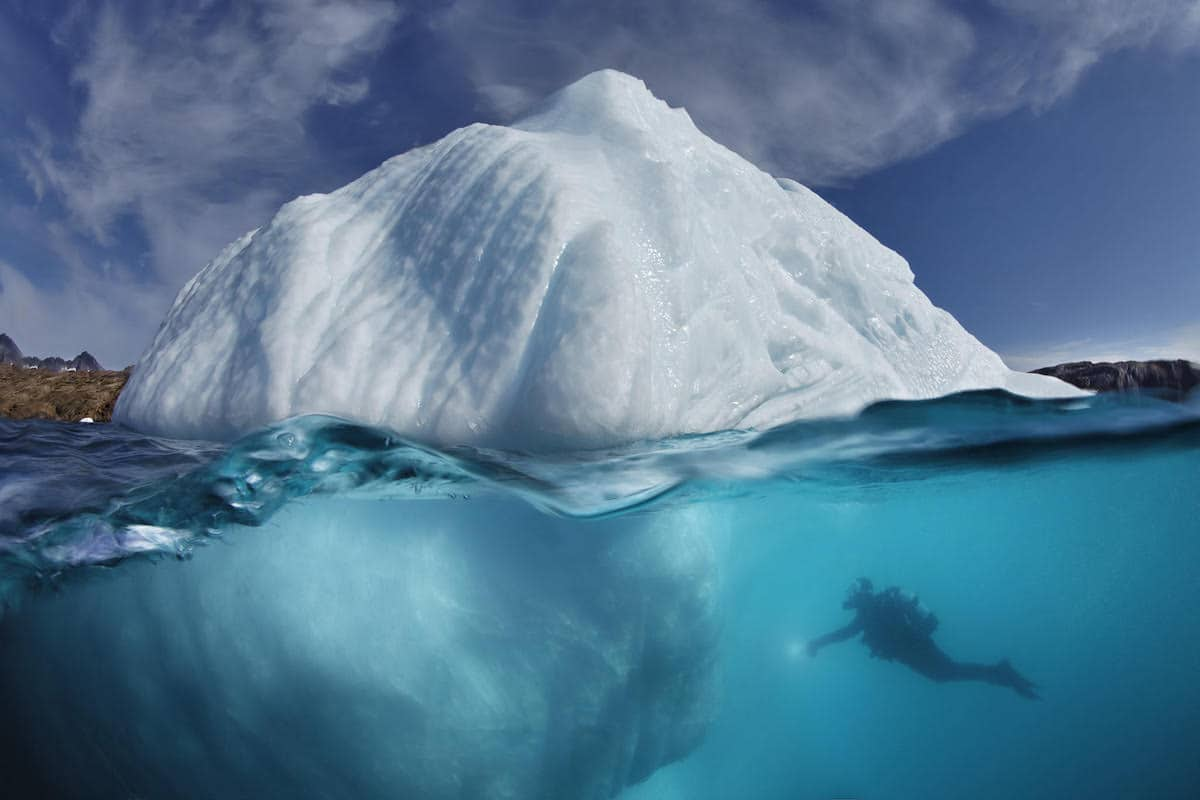 Split Shot of Iceberg Over and Under Water