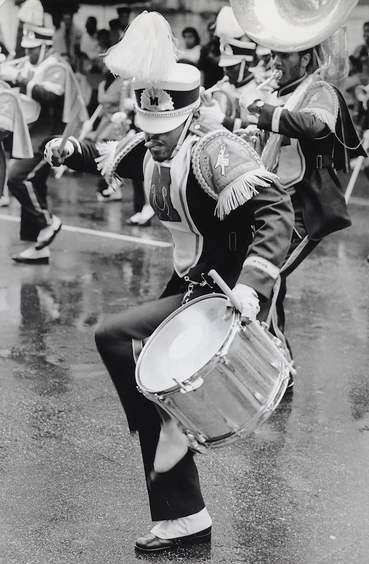 African American marching band member drumming on a snare drum