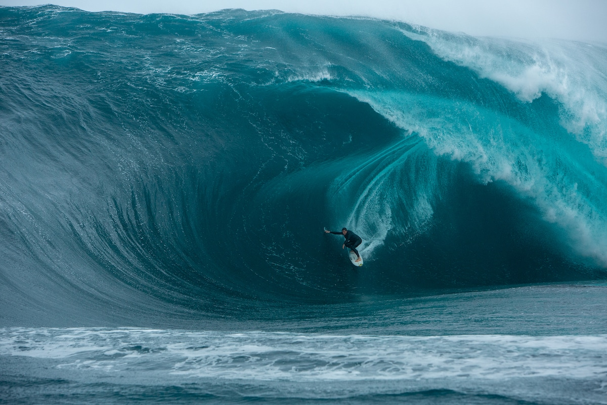 Barrel of a Wave Surrounding a Surfer