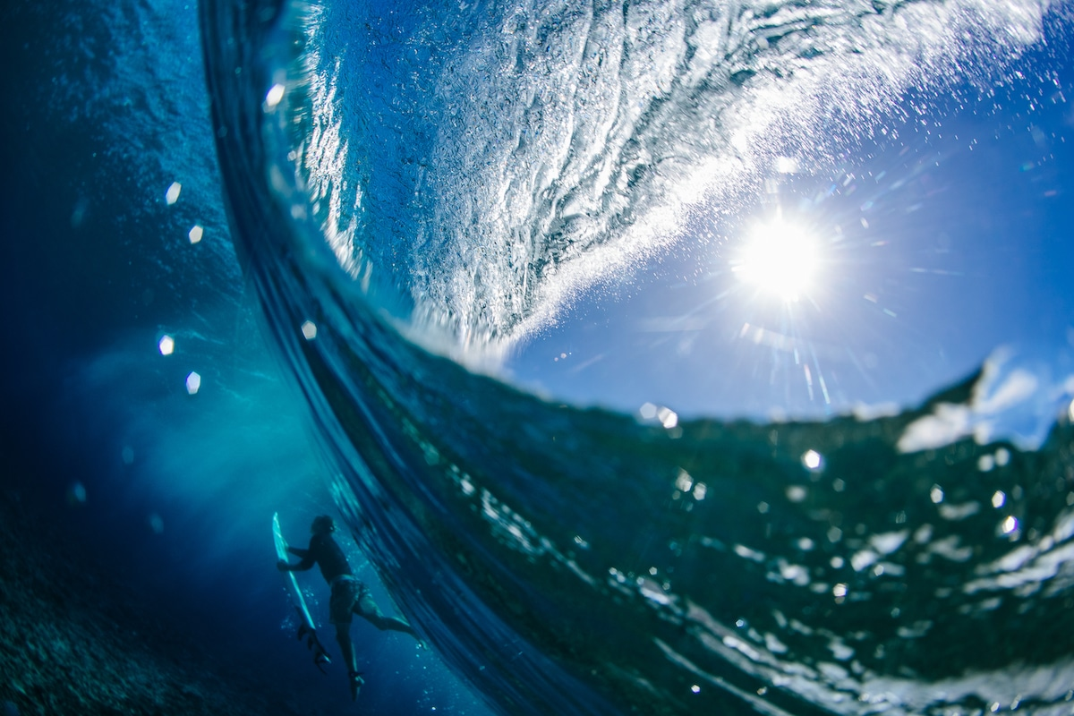 Surfer Underwater with Wave Crashing down